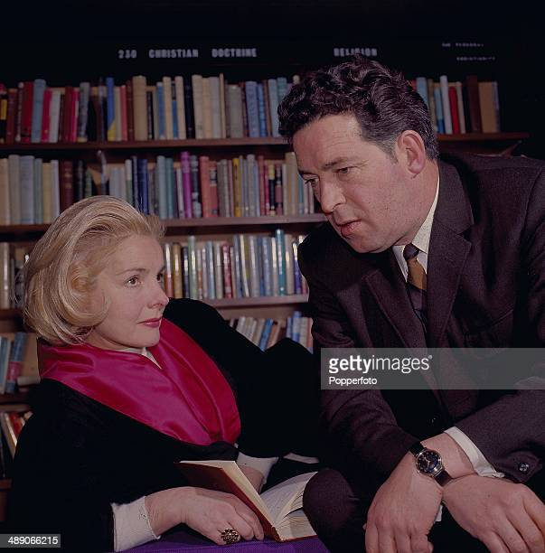 British actress Elizabeth Sellars and English actor John Gregson pictured in a library scene from the television drama 'Person Unknown' in 1968