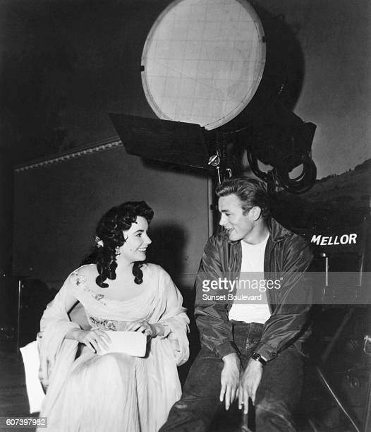 British actress Elizabeth Taylor and American actor James Dean on the set of Rebel Without a Cause directed by Nicholas Ray