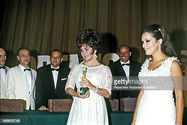 British actress Elizabeth Taylor being awarded as Best foreign actress with the David di Donatello at the ancient theatre of Taormina Jokingly he...