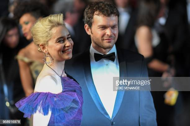 British actress Emilia Clarke and US actor Alden Ehrenreich pose as they leave the Festival Palace on May 15 2018 after the screening of the film...