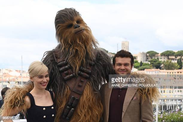 British actress Emilia Clarke Chewbacca and US actor Alden Ehrenreich pose on May 15 2018 during a photocall for the film 'Solo A Star Wars Story' at...