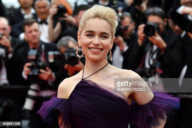 """British actress Emilia Clarke poses as she arrives on May 15, 2018 for the screening of the film """"Solo : A Star Wars Story"""" at the 71st edition of..."""