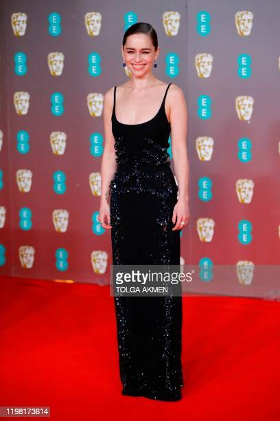 British actress Emilia Clarke poses on the red carpet upon arrival at the BAFTA British Academy Film Awards at the Royal Albert Hall in London on...