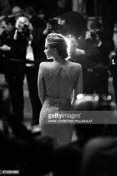 British actress Emily Blunt poses as she leaves the Festival palace after the screening of the film 'Sicario' at the 68th Cannes Film Festival in...