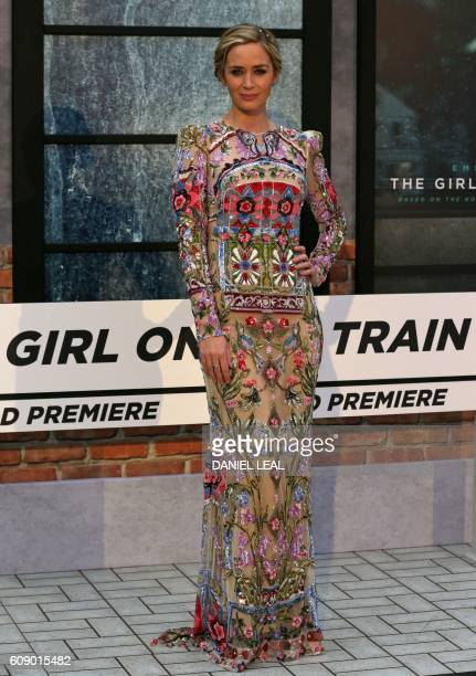 British actress Emily Blunt poses for photographers as she arrives to attend the World Premiere of the film 'The Girl on the Train' in central London...
