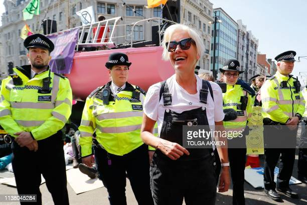 TOPSHOT British actress Emma Thompson gestures as police surround the pink boat being used as a stage by climate change activists as they occupy the...