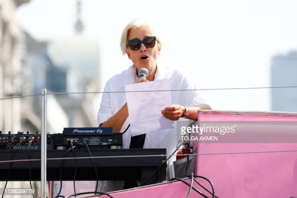 British actress Emma Thompson gives an address from the stage atop the pink boat to climate change activists occupying the road junction at Oxford...