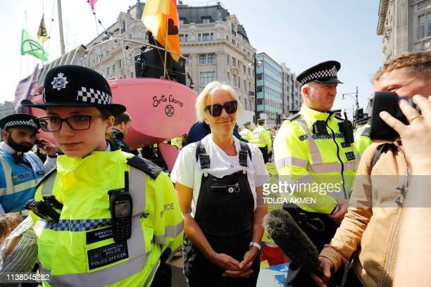 British actress Emma Thompson poses for the media as police surround the pink boat being used as a stage by climate change activists as they occupy...