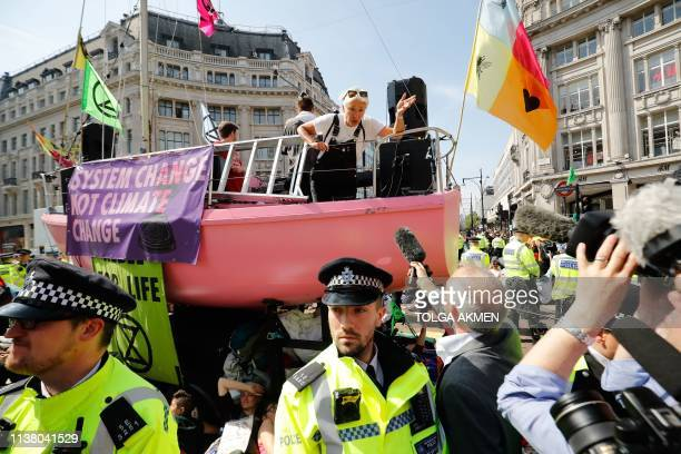 British actress Emma Thompson talks to members of the media from atop the pink boat after police officers surrounded the boat being used as a stage...