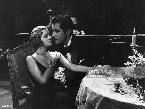 British actress Evelyn Laye with John Boles in a scene from the film 'One Heavenly Night' directed by George Fitzmaurice for Samuel Goldwyn