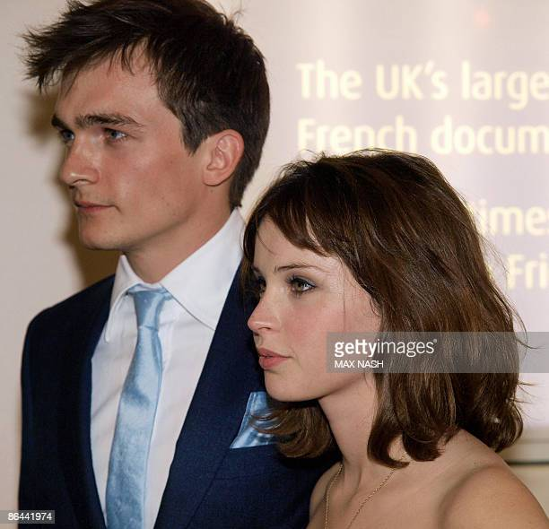 British actress Felicility Jones arrives with her costar Rupert Friend at the British Premiere of their latest film ' Cheri' at the French Institute...