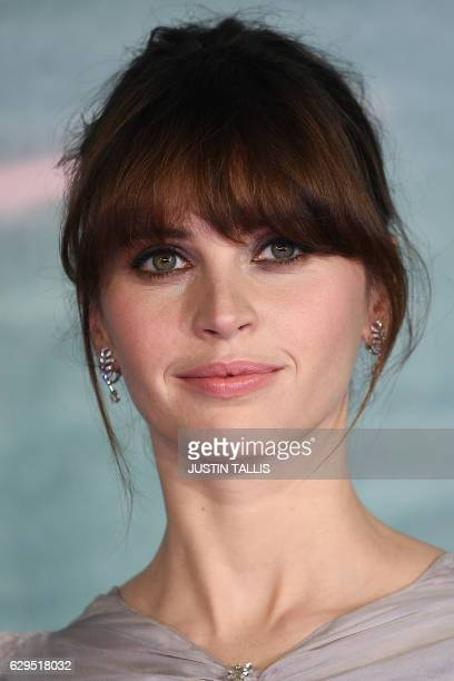 """British actress Felicity Jones poses on the red carpet upon arrival at the UK launch event of Lucasfilm's """"Rogue One: A Star Wars Story"""", at the Tate..."""