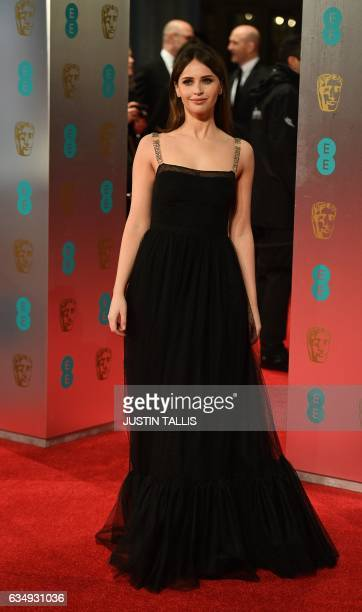 British actress Felicity Jones poses upon arrival at the BAFTA British Academy Film Awards at the Royal Albert Hall in London on February 12 2017 /...