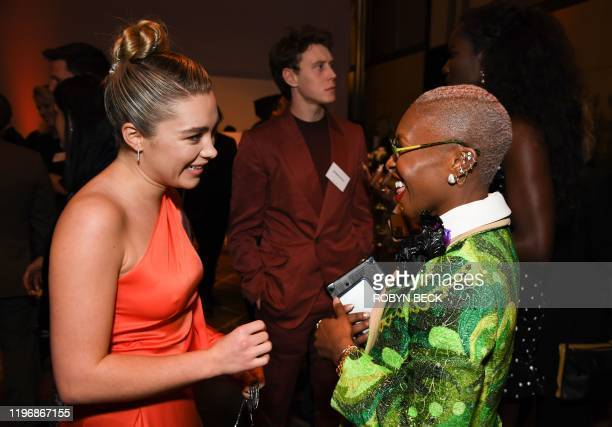 British actress Florence Pugh talks with British actress Cynthia Erivo during the 2020 Oscars Nominees Luncheon at the Dolby theatre in Hollywood on...