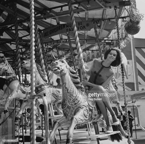 British actress Gabrielle Drake riding a carousel horse UK 12th August 1969