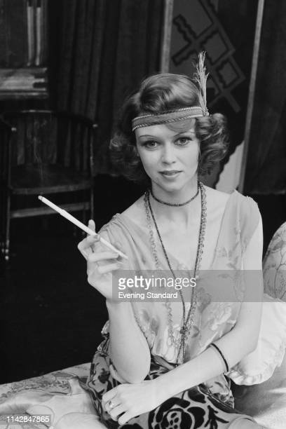 British actress Gabrielle Drake wearing 1920s costume smokes a cigarette UK 3rd October 1975