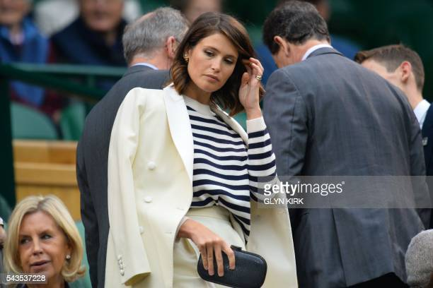 British actress Gemma Arterton takes her seat in the royal box to watch Poland's Agnieszka Radwanska play against Ukraine's Kateryna Kozlova during...
