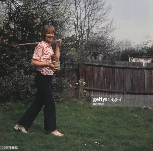 British actress Glenda Jackson heads out to the garden circa 1970