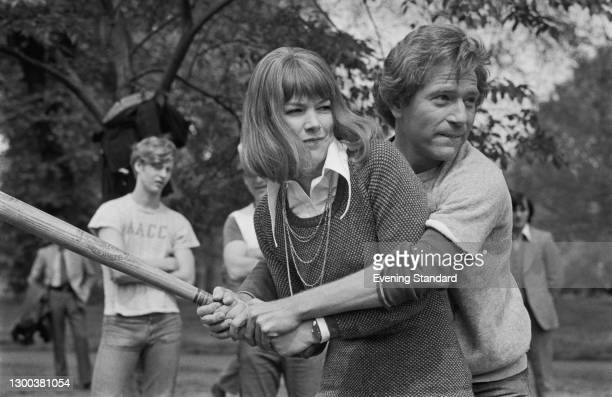 British actress Glenda Jackson plays baseball with her American co-star George Segal in London's Hyde Park, to promote their latest film 'A Touch of...
