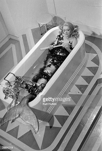British actress Glynis Johns dressed as a mermaid in a scene from the film 'Miranda' Original Publication Picture Post 4457 A Mermaid Has Tail...