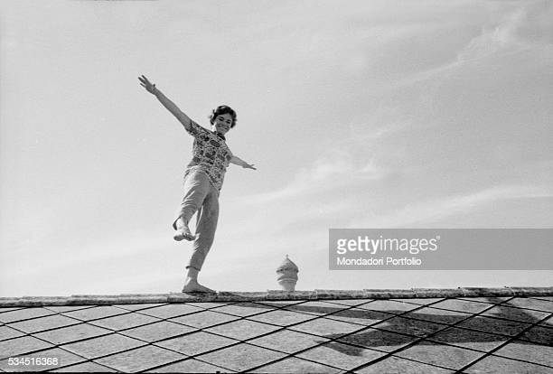 British actress Heather Sears walking on a roof during the XVIII Venice International Film Festival Venice 1957