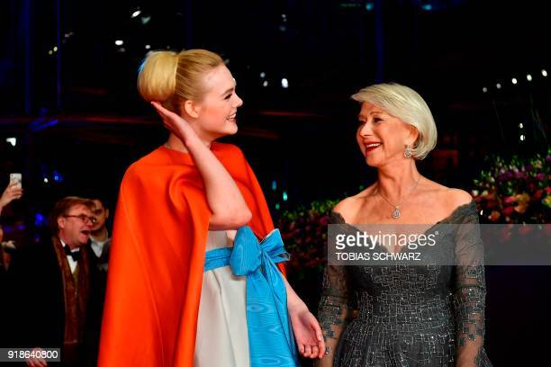 British actress Helen Mirren and US actress Elle Fanning pose on the red carpet upon her arrival at the Berlinale Palace for the opening ceremony of...