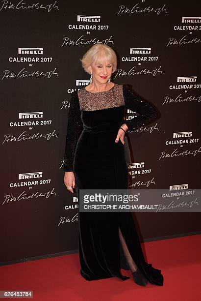 British actress Helen Mirren poses during a photocall ahead of a gala dinner held for the international launch of the 2017 Pirelli calendar at the...