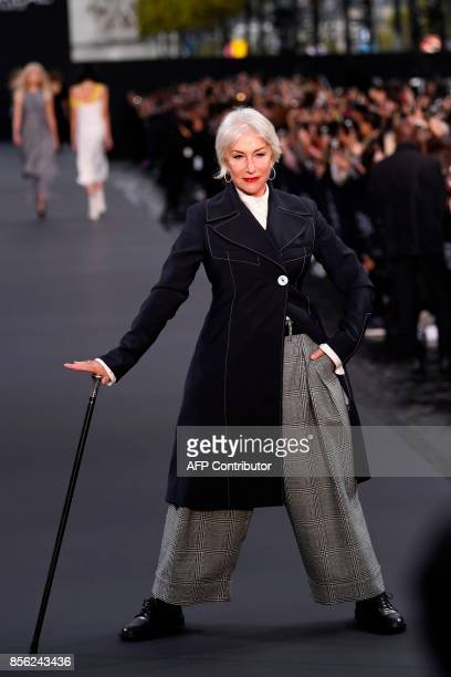 TOPSHOT British actress Helen Mirren poses during the L'Oreal fashion show which theme is Paris on the sidelines of the Paris Fashion Week on October...