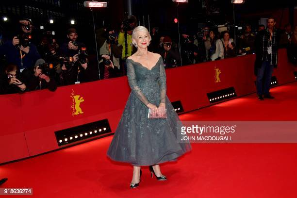 British actress Helen Mirren poses on the red carpet upon her arrival at the Berlinale Palace for the opening ceremony of the 68th Berlinale film...