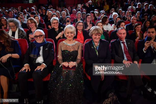 British actress Helen Mirren sits next to Federal Government's Commissioner for Culture and the Media Monika Gruetters before recieving the Honorary...