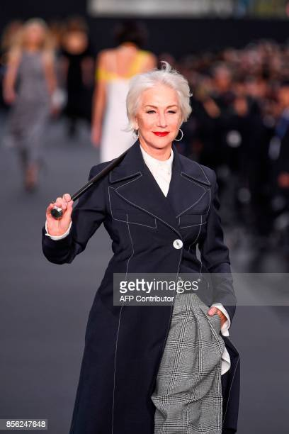 British actress Helen Mirren takes part in the L'Oreal fashion show which theme is Paris on the sidelines of the Paris Fashion Week on October 1 on a...