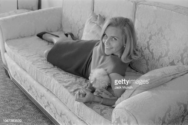British actress Honor Blackman lying on a sofa Cannes France 24th January 1965 She is in Cannes to film psychological thriller film 'Moment to Moment'