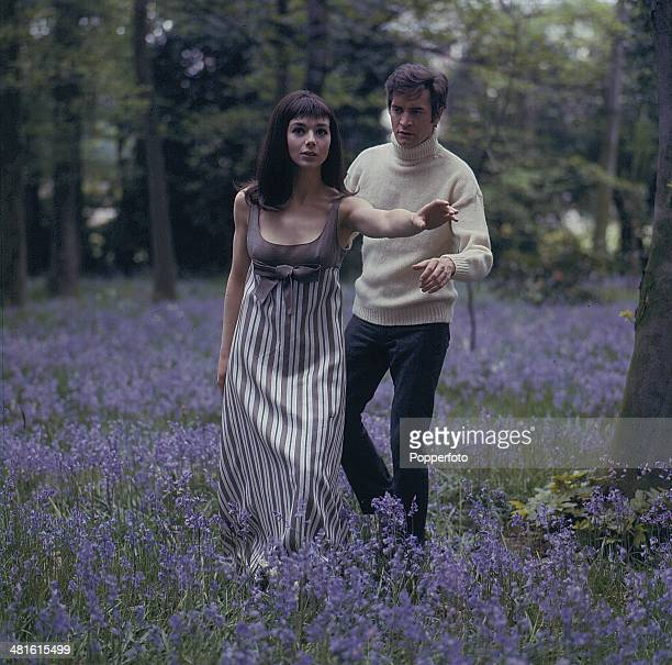 1968 British actress Jacqueline Pearce and English actor Patrick Mower pictured in a scene from the television series 'Haunted I Like it Here' in 1968