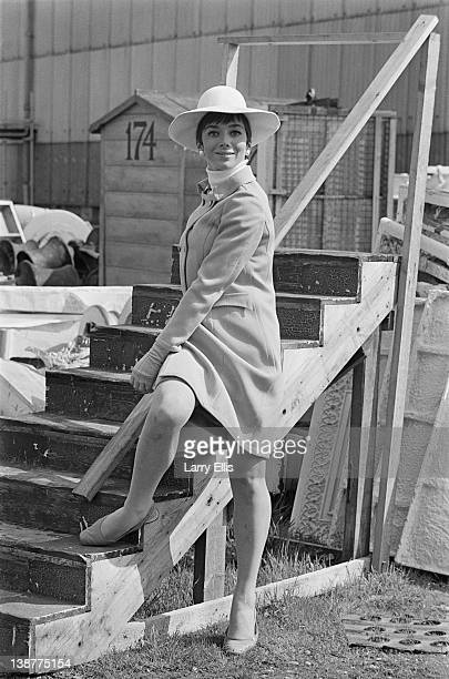 British actress Jacqueline Pearce posing outside Shepperton Studios, where she is filming the Jerry Paris comedy 'Don't Raise The Bridge, Lower The...