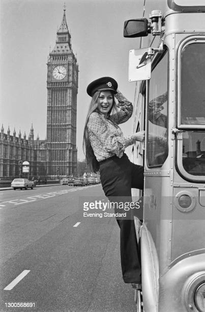 British actress Jane Seymour boards a bus outside the Palace of Westminster in London, UK, 26th April 1973. She starred in the James Bond film 'Live...