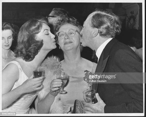 British actress Janette Scott attending a party at the Garrick Theatre with her mother British actress Thora Hurd and English writer Walter Greenwood...