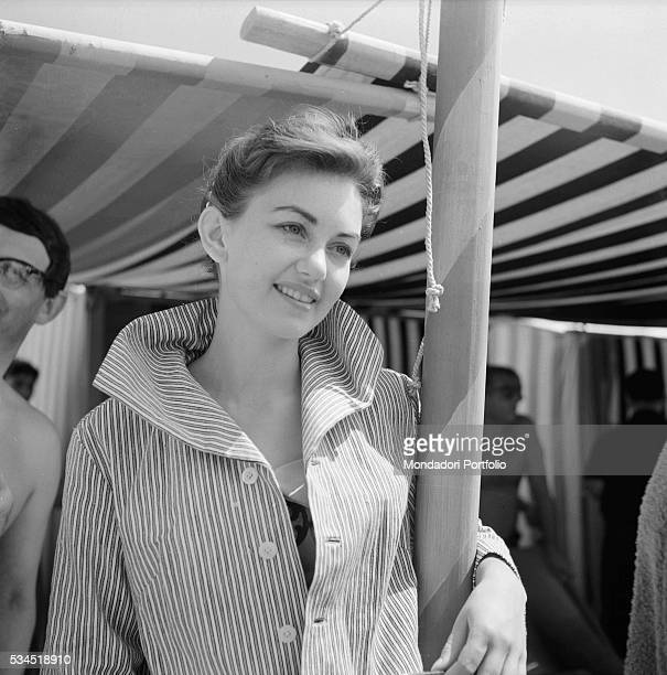 British actress Janette Scott smiling and leaning on a pole during the XVIII Venice International Film Festival Venice 1957