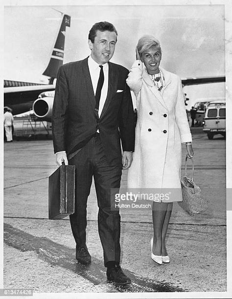 British actress Janette Scott with British television presenter and compere David Frost at London Airport 1964