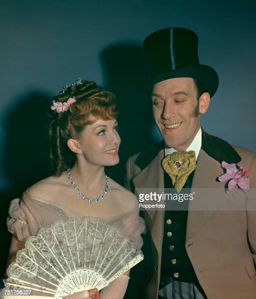 British actress Jean Kent and English comedian Tommy Trinder pictured together in a scene from the musical film 'Champagne Charlie' in London in June...