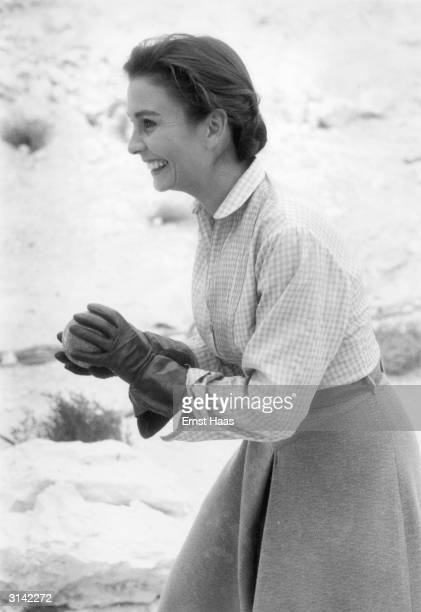 British actress Jean Simmons playing ball with Gregory Peck on the set of 'The Big Country' a western directed by William Wyler