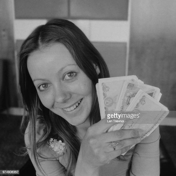 British actress Jenny Agutter holding 1000£ cash prize for lottery Premium Bond, UK, 30th March 1973.