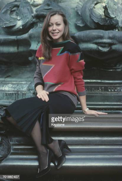 British actress Jenny Agutter sitting at the foot of the Shaftesbury Memorial Fountain in London circa 1985