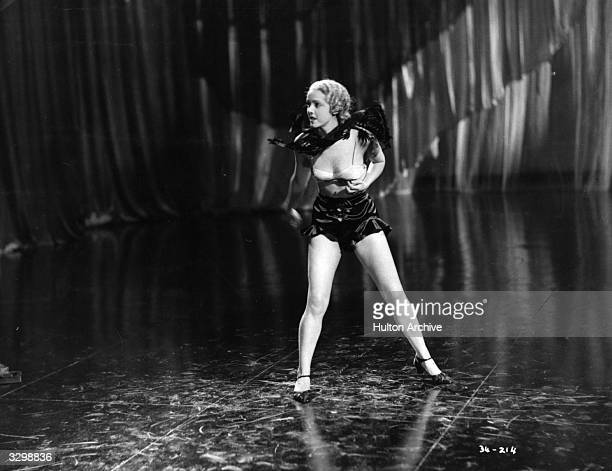 British actress Jessie Matthews wearing a futuristic costume for a dance number from the film 'Evergreen' directed by Victor Saville for Gaumont