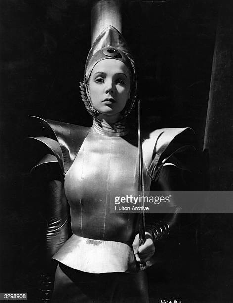 British actress Jessie Matthews wearing futuristic armour in a scene from the film 'Evergreen' directed by Victor Saville for Gaumont