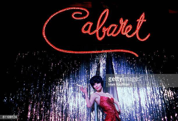 British actress Jill Haworth playing Sally Bowles stands under a giant sign in scene from Broadway musical 'Cabaret' performed at the Broadhurst...