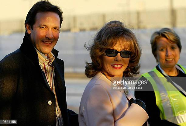 British actress Joan Collins and her husband come off the Concorde last flight from New York BA 002 at Heathrow international airport in London 24...