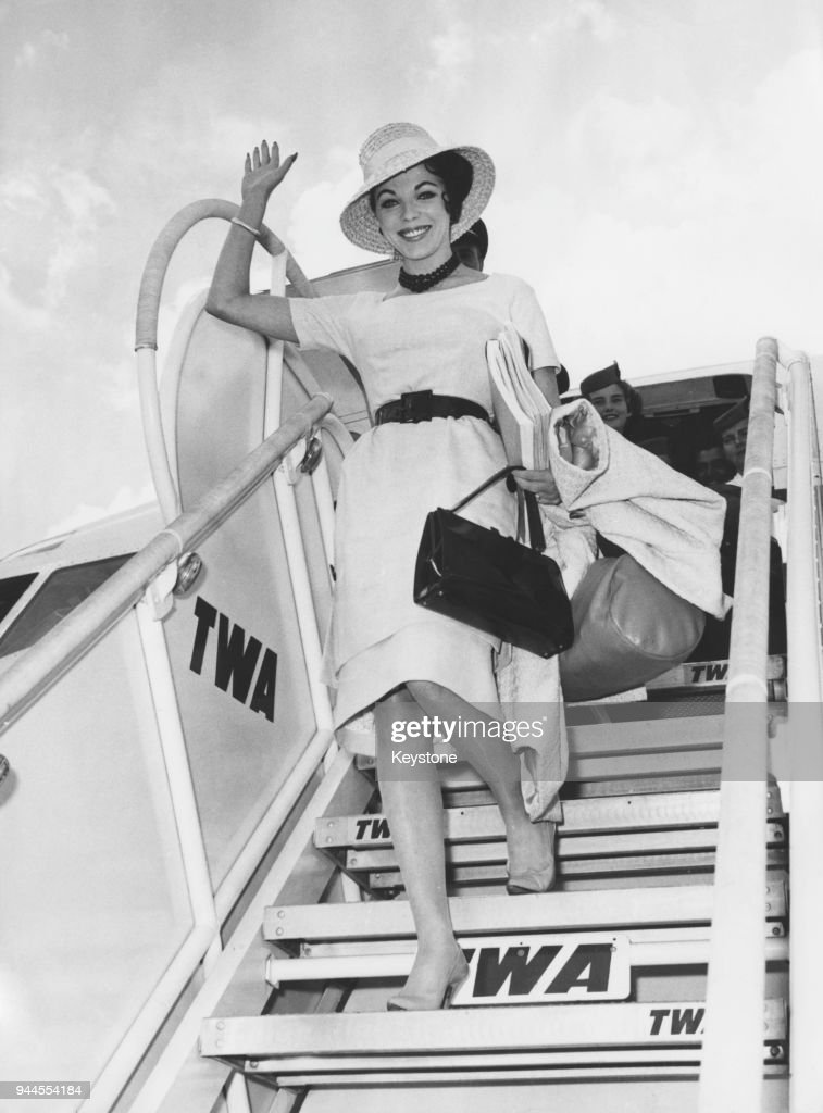 British actress Joan Collins arrives at Ciampino Airport in Rome, Italy, to star in the film 'Esther and the King', 13th June 1960.