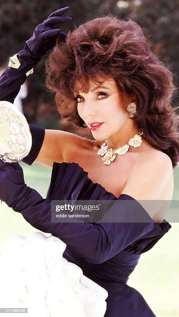 British Actress Joan Collins Checks Her Hair And Makeup In A Hand News Photo Getty Images