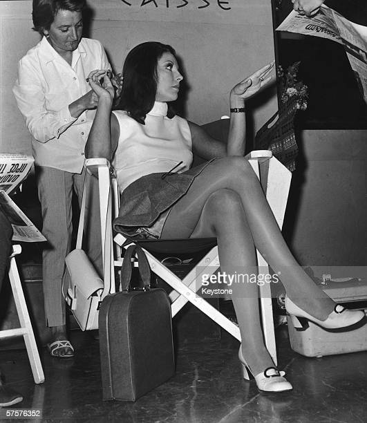British actress Joan Collins prepares to shoot a scene for 'The Executioner' directed by Sam Wanamaker at the Hilton Hotel in Athens 22nd May 1969