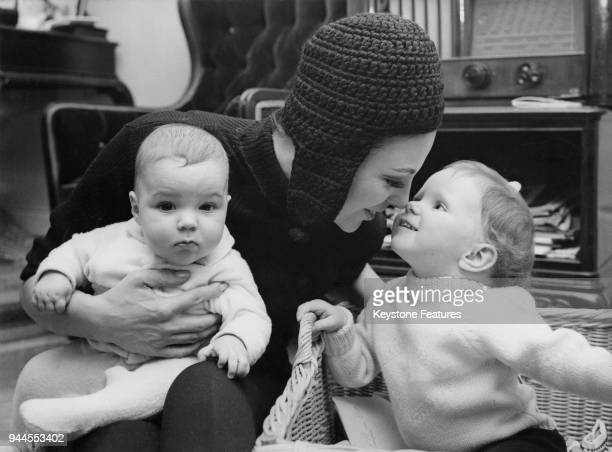 British actress Joan Collins wife of actor and singer Anthony Newley with her daughter Tara and son Alexander at the Palace Hotel during a holiday in...